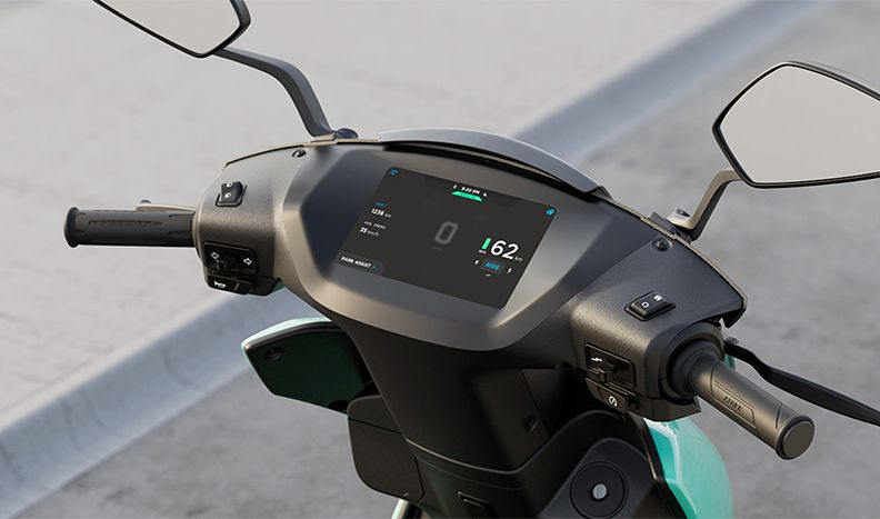 Close-up of the Ather 450x scooter handle bars and dashboard touchscreen.