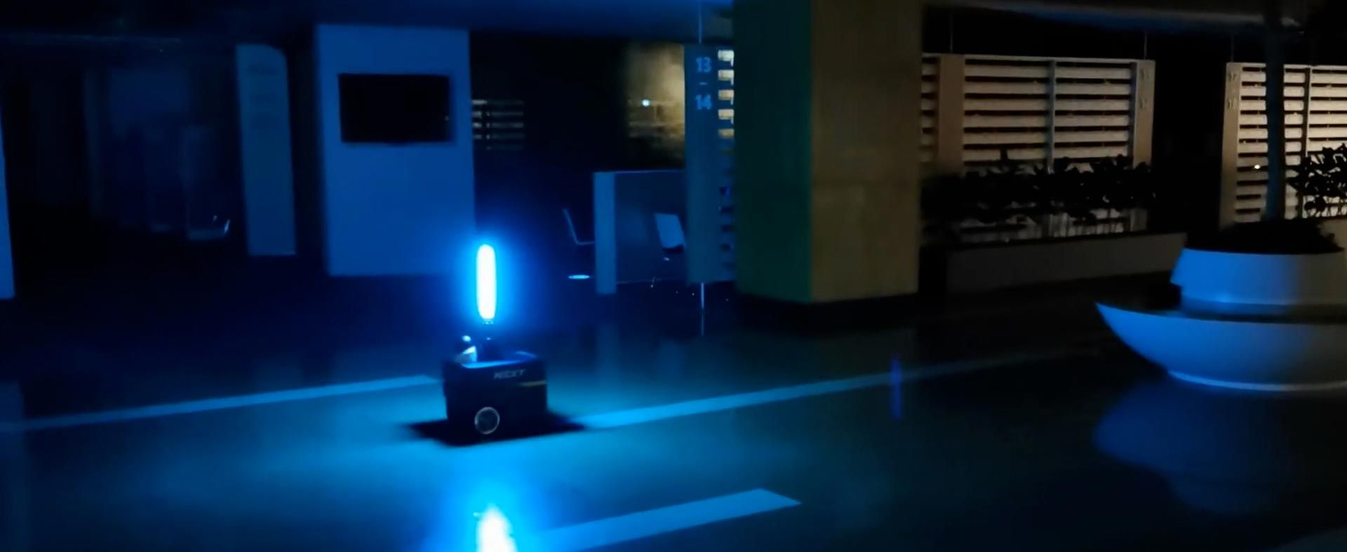 An autonomous robot inside a commercial space with a mounted UV light disinfects building interiors.